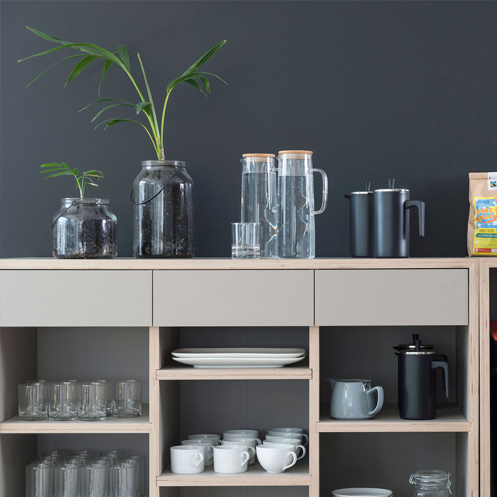 A kitchenette equiped with tea, coffee & water